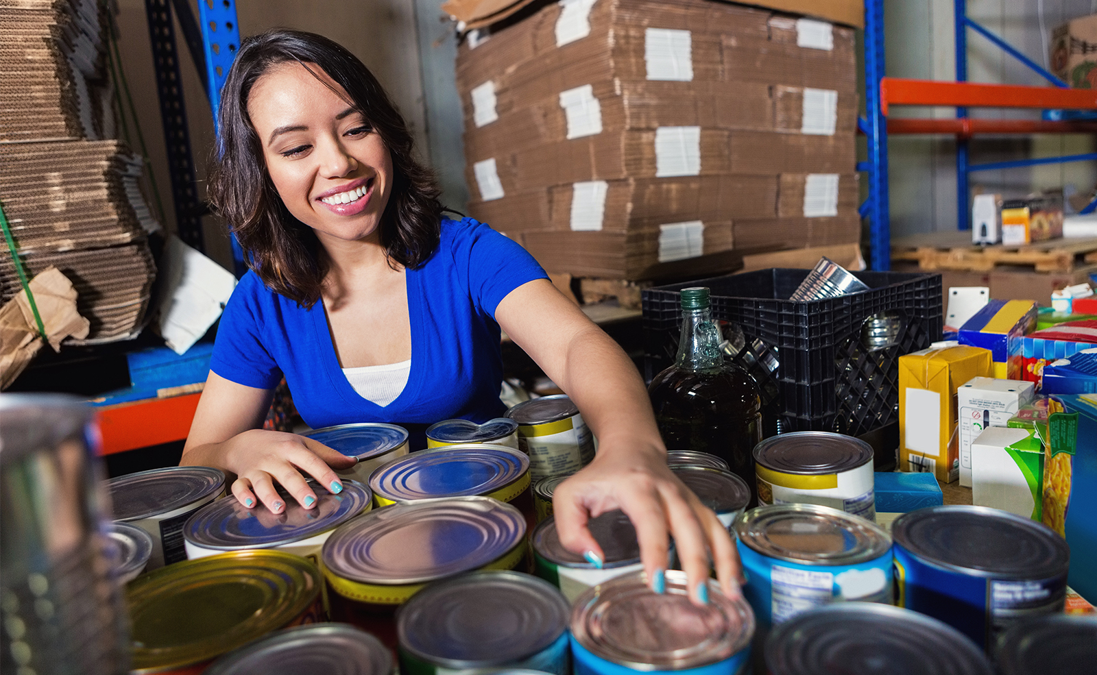 woman smiling with canned food
